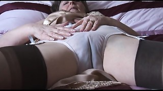 Hirsute grandmother in slide and nylons with watch thru pants disrobes