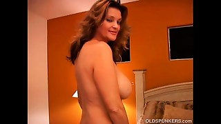 Nasty MILF plays with her twat and blows the cameraman